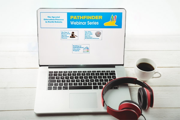 Webinar on a computer screen with headphones
