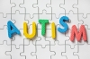 The word autism on a puzzle background