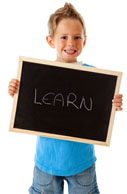 Boy with Learn Sign